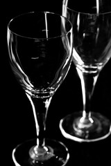 Two glasses with black background