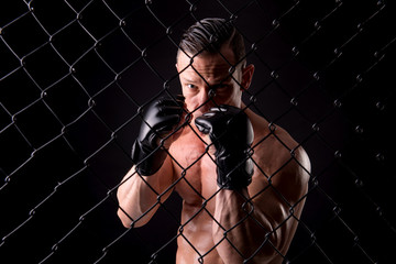 fighter posing with gloves isolated on a dark background