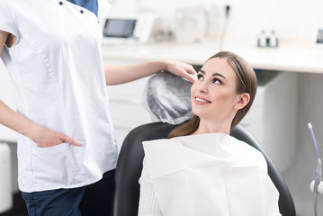 Smiling client leaning on seat in odontology