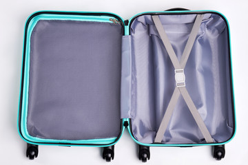 Large open fashionable suitcase. Empty luggage on wheels for journey.