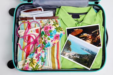 Pictures of resorts and beach clothing. Suitcase ready for your departure.