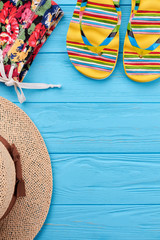 Vertical image of beach items. Cropped picture of colorful vacation clothing. Fashion for resort.