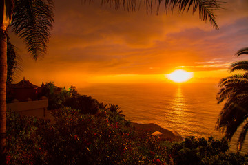 Amazing orange sunset view by the Atlantic ocean on Canary islands