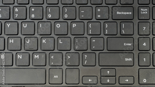 Wall mural keyboard close up with notebook top view