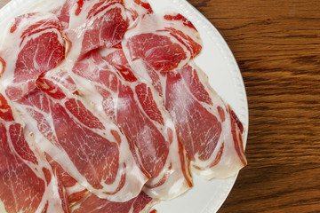 Classic spanish tapas: sliced ham served on a dish. Spanish name Jamon Iberico.
