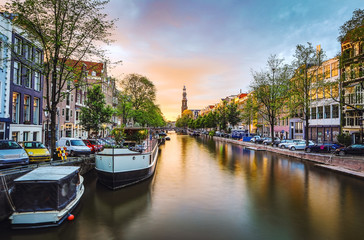 The most famous canals and embankments of Amsterdam city during sunset. General view of the...
