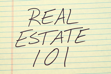 """The words """"Real Estate 101"""" on a yellow legal pad"""
