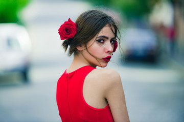 Adorable girl with red lips, makeup on cute, young face