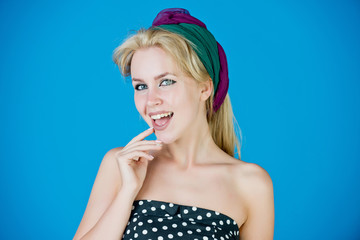 beauty and fashion, woman smiling with turban and makeup, pinup
