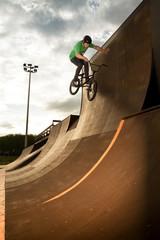 BMX biker performing a stunt on a sports ramp