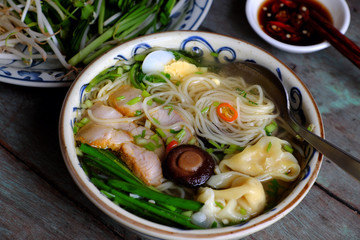 Vietnam food, egg noodle soup with wontons