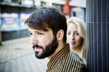 Portrait of young couple in town