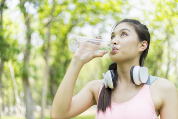 beautiful sport girl drinking water after jogging , sport concept