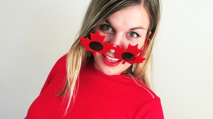 Happy young woman celebrating Canada Day, 150th Anniversary
