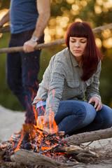 Young woman arranging firewood, Osijek, Croatia