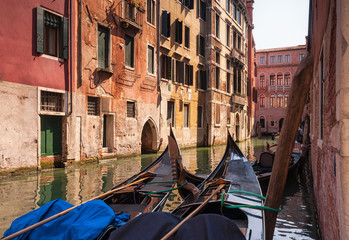 Two gondolas in a small medieval canal. Venice, Italy