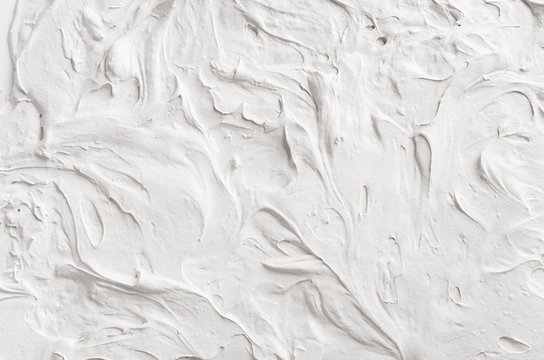 White decorative abstract plaster texture with waves and surf.
