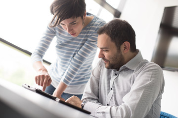 Two Business People Working With Tablet in startup office