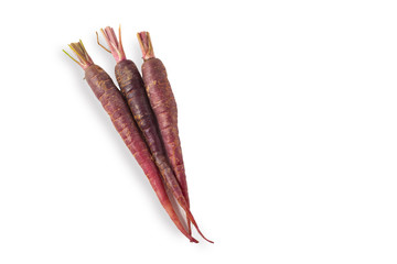 Bunch of Purple Baby Carrots on White Background