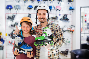 Father and son enjoying purchased roller-skates