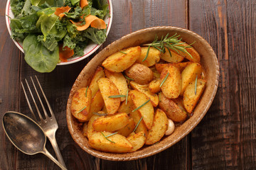 Baked potatoes with salad