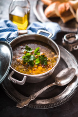Greek chickpea soup  in the pot on the metal background