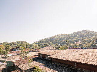 roofs of country house with mountain and clear sky in the morning