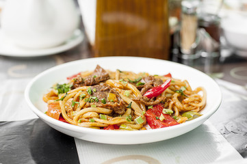 Noodles with mutton and vegetables. Central Asian cuisine. Lagman