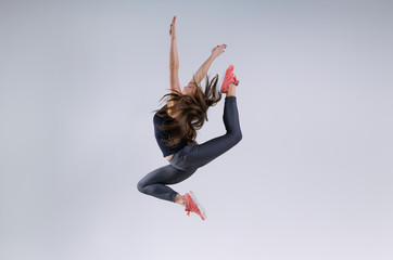 Girl in jump on a gray background