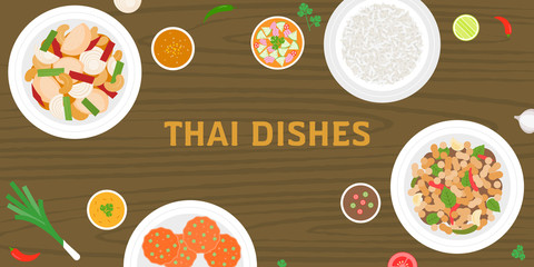 Thai dishes, mango with sticky rice, pad thai noodles, fried rice bake with pineapple on wooden background