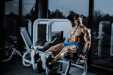 Leg Exercises - Man Doing Leg With Machine In Gym