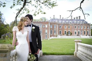 Wedding preparations, Bride and bridegroom in park, Dorset, England