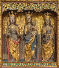 BERLIN, GERMANY, FEBRUARY - 16, 2017: The carved polychrome gothic altar withe the Madonna and St. Catherine and Ursula in church Marienkirche by unknown artist of 15. cent.