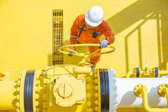 Offshore oil and gas operations, production operator open valve to allow gas flowing to sea line pipe for sent gas and crude oil to central processing platform, oil and gas maintenance and service