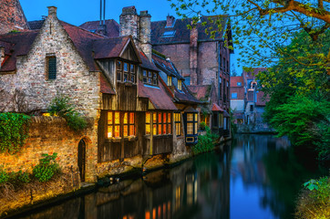 Photo sur Toile Bruges Medieval houses over canal in Bruges Belgium evening landscape