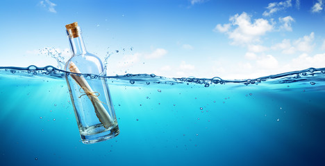 Message In Bottle floating In The Ocean