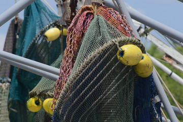 colorful shrimp boat nets with yellow floats, closeup