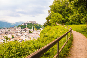 View of  Salzburg castle (Festung Hohensalzburg) and old town from a walking path along Monchsberg. Beautiful view of Salzburg, Austria.