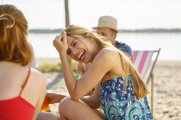 Vivacious young woman enjoying a joke