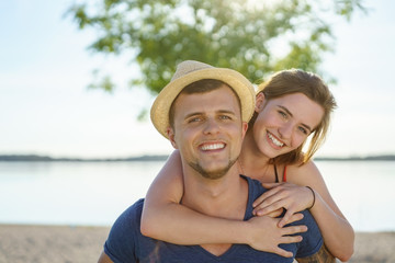 Happy young couple enjoying a day at the beach