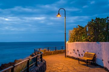 Night lantern on the ocean shore