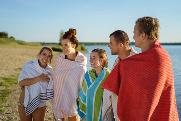 Group of colorful young people wrapped in towels
