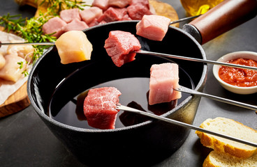 Assorted meat ready to be dipped in a fondue pot