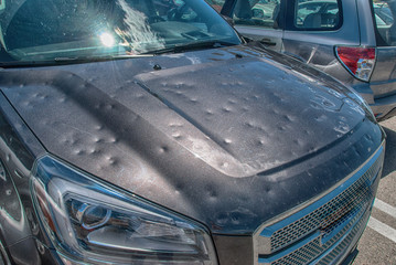 Hail damage to car