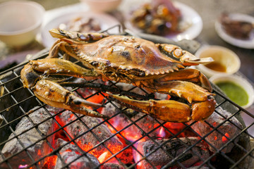 Grilled crab on a flaming grill, Thailand street food
