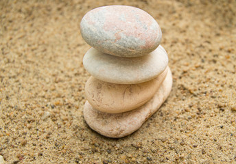 Zen stones on the beach for a perfect meditation, a blurred background