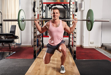 Man doing lunges with barbell