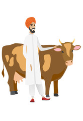 Farmer standing with crossed arms near cow.