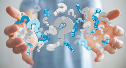 Businessman using 3D rendering question marks