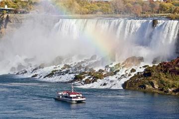 Beautiful image with amazing Niagara waterfall, rainbow, and a ship